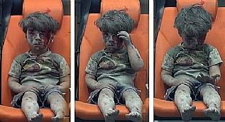Enkazdan kurtar�lan Suriyeli �ocu�un insanl��� utand�ran g�r�nt�s�