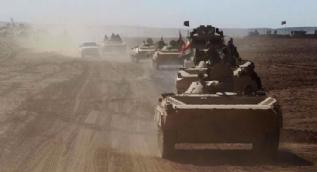 Irak güçlerini yolda karşılayan Kerküklüler