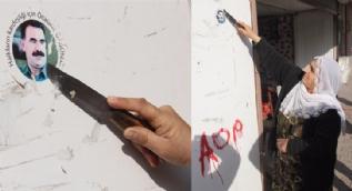 Polisi gören kadın Abdullah Öcalan çıkarmasını bıçakla kazıdı