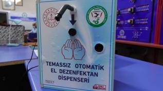 Meslek lisesi öğretmenleri 'temassız' el dezenfektan cihazı üretti